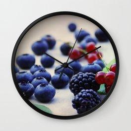 Fresh wild berries, blackberries, blueberries and currants in still life Wall Clock
