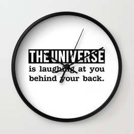 The universe is laughing at you behind your back Wall Clock