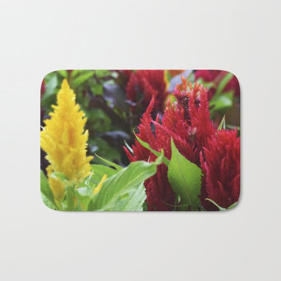 red , yellow, and pink flowers planted in the flower bed Bath Mat