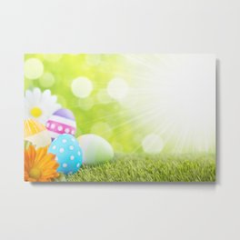 Decorated Easter eggs in the grass with a green background Metal Print