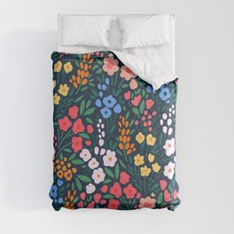 Vintage floral background. Flowers pattern with small colorful flowers on a dark blue background.  Comforters
