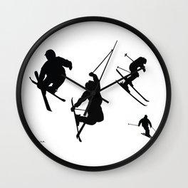 Skiing silhouettes Wall Clock