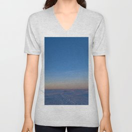 Dawn in the blue cloudless sky over the white snow ice desert of the frozen sea Unisex V-Neck