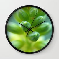 greg guillemin Wall Clocks featuring Green plant macro - Greg Katz by Artlala for MSF Doctors Without Borders