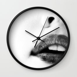 the unbearable kiss of a stranger Wall Clock