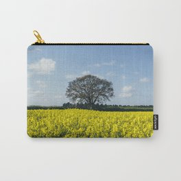 Field of Rapeseed (Canola) and tree against a sunlit blue sky. Norfolk, UK. Carry-All Pouch