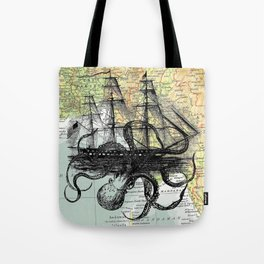 Octopus Attacks Ship on map background Tote Bag
