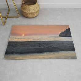 Last Minute At The Beach. At Sunset Rug