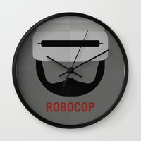 robocop Wall Clocks featuring ROBOCOP by Alejandro de Antonio Fernández