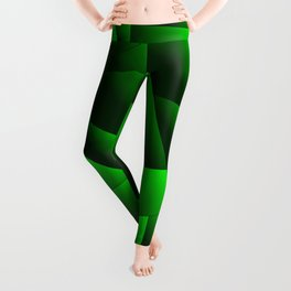 Dark overlapping sheets of green paper triangles. Leggings