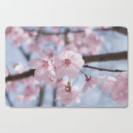Two pink cherry blossoms & blue sky Cutting Board