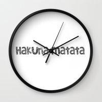 hakuna Wall Clocks featuring Hakuna Matata by Louise