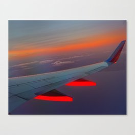 On the Wing of a Sunset Canvas Print