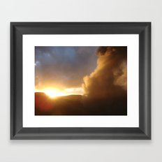 Sunset over a erupting volcano Framed Art Print