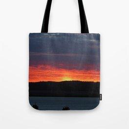 Lindisfarne castle sunset Tote Bag