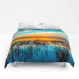 Sunset on the river Comforters