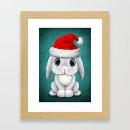 White Floppy Eared Baby Bunny Wearing a Santa Hat Framed Art Print