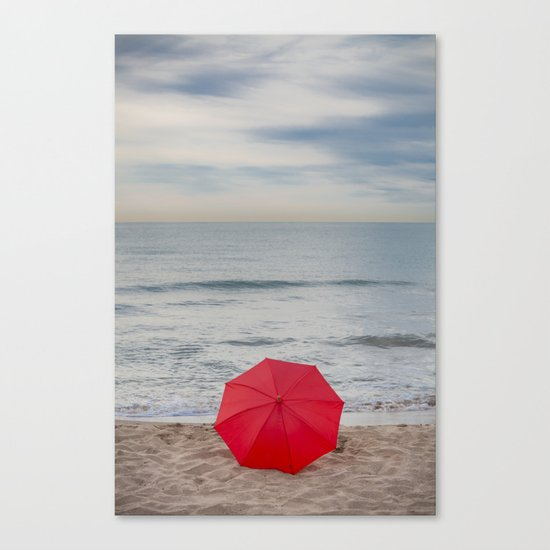 Red Umbrella lying at the beach III Canvas Print