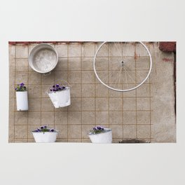 Wall Art: flowers, pot and bicycle wheel on the wall Rug