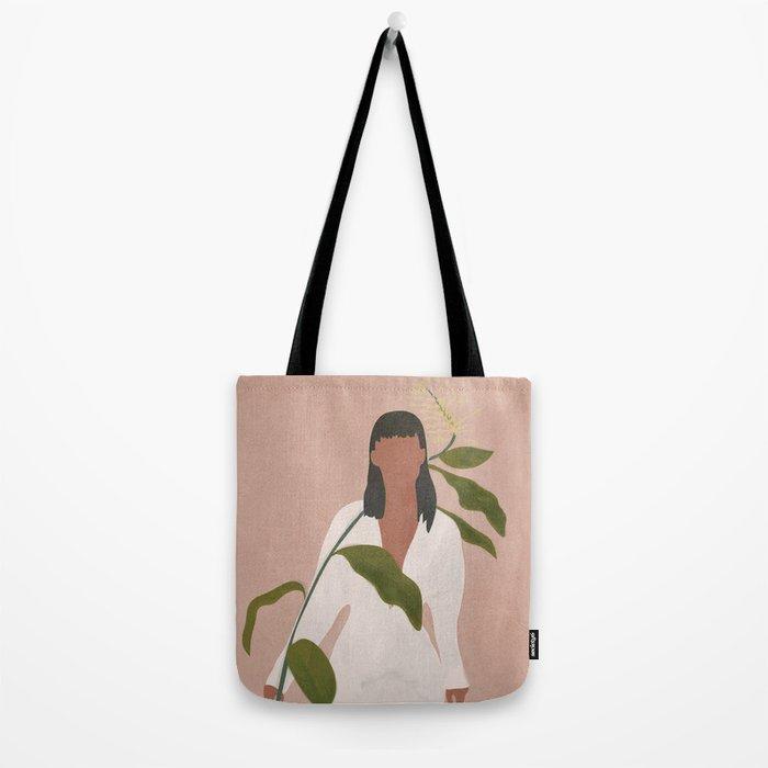 Elegant Lady holding a Flower Tote Bag