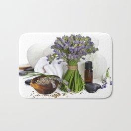 lavender spa (fresh lavender flowers, towel, essential oil, pebbles, Herbal massage balls) over whit Bath Mat