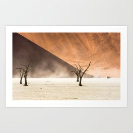 People silhouettes and dead trees, surrounded by huge sand dunes of Namib Desert Art Print