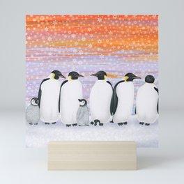 emperor penguins and chicks winter sunset Mini Art Print