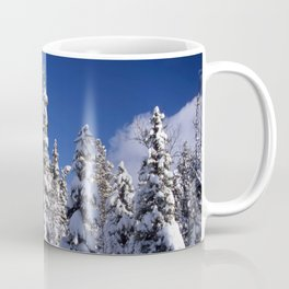 Snow covered trees in the forest. Winter day with blue sky. Coffee Mug