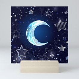 Background with a blue moon Mini Art Print