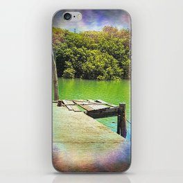 Dilapidated wharf on a tranquil river iPhone Skin