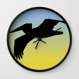 Brown Pelican in Flight Silhouette at Sunrise Wall Clock