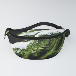 Pine tree branch covered with snow Fanny Pack