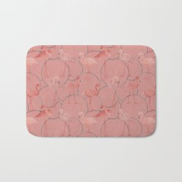 Walk with pink flamingos on coral pink Bath Mat