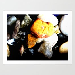 Bright orange rock resting on top of other stones - abstract geological nature Art Print