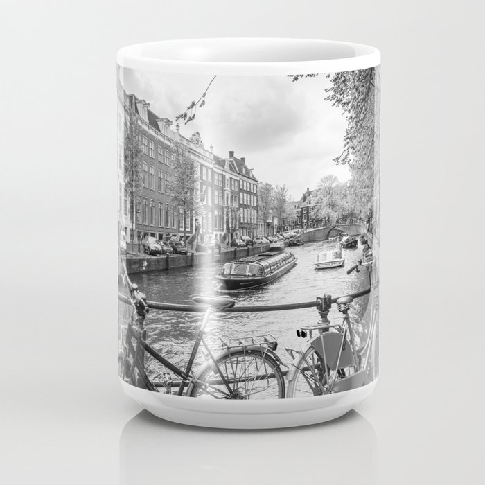 Bicycles parked on bridge over Amsterdam canal Coffee Mug