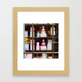 Beautiful colorful tasty macaroons cakes sweets and presents in the boxes display in window at the  Framed Art Print
