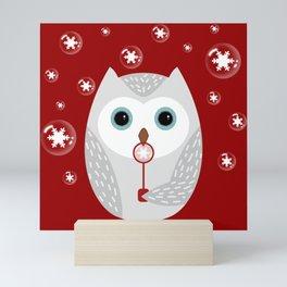 Christmas owl on red Mini Art Print