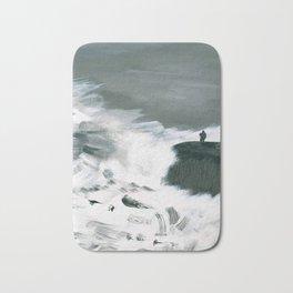 Man Standing on Cliff During Storm Bath Mat
