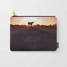 Silhouettes of horses at sunset in the field. Long shadows in the golden hour. Carry-All Pouch