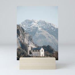 The Dolomites by Day   Dolomites Mountain Range over white church, Italy Travel Photography, Saige Ashton Prints. Mini Art Print
