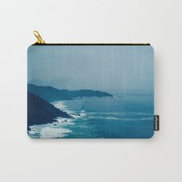 Under A Misty Grey Sky The Blue Waves Meets The Jagged Cliff On The Sore Carry-All Pouch
