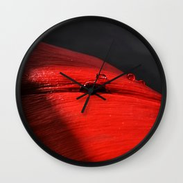 A drop of blood on a red leaf Wall Clock