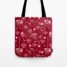 Bright openwork hearts on a red background. Tote Bag