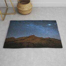Starry Night: Brilliant Blue Stars Behind Rocky Mountain Rug
