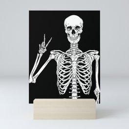 Human skeleton posing isolated over black background vector illustration Mini Art Print