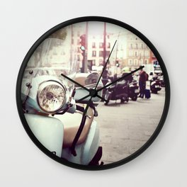 Vintage scooter on city street Wall Clock