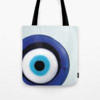 evil eye Tote Bags featuring Evil Eye by SalbyN