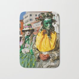 Two street performers wearing traditional Venetian carnival costumes and masks Bath Mat