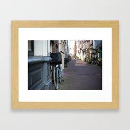 Light blue bike on a Monday morning in Amsterdam. Framed Art Print