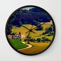 hiking Wall Clocks featuring Hiking through springtime scenery by Patrick Jobst